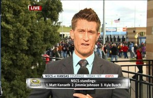 The NASCAR fan behind Marty Smith is going to have  a sudden meeting with the wall ahead of him. (ESPN)