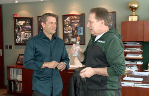 Sports Science's John Brenkus (l) talks with Michigan State's Tom Izzo (r), as the coach swallows an ingestible thermometer to measure his core body temperature.