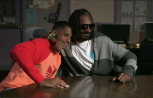 Cordell Broadus with his father Snoop Dogg in a scene of their ESPN mini-series Snoop & Son.