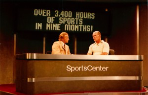 Dallas TX, May 1980: Jim Simpson (l) is shown talking with Dallas Cowboys coach Tom Landry on a SportsCenter set at the NCTA.