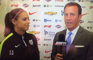 Bob Holtzman with U.S. Women's National Team forward Alex Morgan.