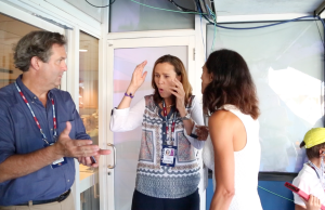 Shriver reacts to a vintage 1991 photo, as seen on a cell phone, of her and her 1991 Pan Am Games foe, Iantosca. ESPN Communications director Dave Nagle (far left) displays the photo. (Jonothon Halley-McLeod/ESPN)