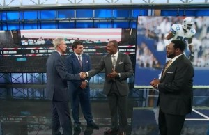 ESPN NFL analyst Darren Woodson (second from right), accepts congratulations for his upcoming Cowboys Ring Of Honor induction from NFL Live host Trey Wingo (left) and fellow ESPN NFL analysts Mark Schlereth (second from left) and Jerome Bettis (far right)