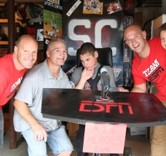 AJ dressed up as a SportsCenter anchor for Halloweenand donned a costume made by his parents, Anthony and  Laurie. From left to right: Roger Jacquemin, Anthony, AJ, Shawn Trudel and  Laurie. (Jonothon Halley McLeod/ESPN)