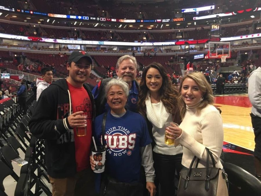 Cassidy Hubbarth (second from right) poses with her family at a Chicago Bulls game. (Photo courtesy of Cassidy Hubbarth/ESPN)